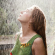 Woman refreshing in the rain — Stock Photo