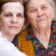 Family portrait - happy grandmother and daughter — Stock Photo