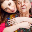 Family - happy young woman and grandmother — Stock Photo