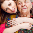 Family - happy young woman and grandmother — Stock Photo #9663722