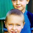 Постер, плакат: Two happy boys brothers or friends