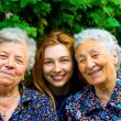 Young woman and two senior ladies — Stockfoto