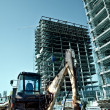 Construction site - excavator and scaffolds — Stock Photo