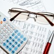 Financial report - calculator, glasses and papers — Stock fotografie