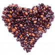 Heart shape formed by bunch of coffee beans — Stock Photo