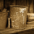 Stock Photo: Vintage objects - two rusty greasy cans on wooden shelf
