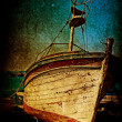 Wreck of rusty antique boat in grunge style — Stock Photo