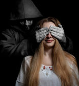 Death concept: woman surprised by evil sinister man — Stock Photo