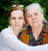Family - middle age daughter and senior mother — Stock Photo