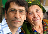 Family portrait - mature son and grandmother — Stock Photo