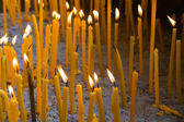 Wax candles burning in church for Easter — Stock Photo
