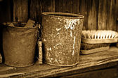 Vintage objects - two rusty greasy cans on wooden shelf — Stock Photo