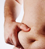 Man holding his fat belly isolated on white — Stock Photo