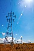 Power lines, blue sky and sun light — Stock Photo