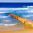 Stock Photo: Footbridge at sandy seashore