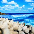 Stock Photo: Colorful scene - blue sea, sky and puffy clouds