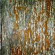 Abstract wood textured backdrop with peeling dye — Stock Photo