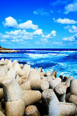 Colorful scene - blue sea, sky and puffy clouds — Stock Photo