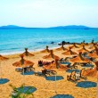 Straw umbrellas on peaceful beach in Bulgaria — Stock Photo