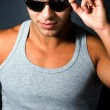 Handsome young sexy man with sunglasses — Stock Photo