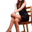Woman with nice sexy legs sitting on chair — Stock Photo #9921229