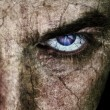 Cracked face with sinister evil scary eyes — Stockfoto