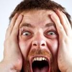 Win concept - scream of happy amazed man — Stock Photo