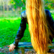 Woman with amazing long hair - Stok fotoraf