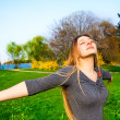 Happy and free young beautiful woman outdoor — Stock Photo #9921609