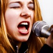 Rock music singer - woman with microphone — Stock Photo #9921618