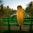 Back of woman sitting alone on park bench — Stock Photo #9921680