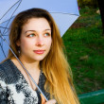 Beautiful sensual blond woman with umbrella — Stock Photo