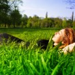Carefree concept - woman relaxing outdoor in grass — Stock Photo #9921696