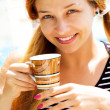 Smile of young woman holding coffee cup — Stock Photo #9921698