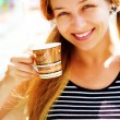 Beautiful smiling woman and coffee cup — Stock Photo #9921699