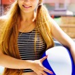 Summer leisure - active happy woman holding a ball — Stock Photo #9921701