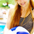 Happy beautiful woman with ball on holiday — Stock Photo #9921704