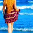 Back of blonde sexy woman walking into the sea — Stock Photo