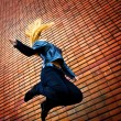 Young energic woman jumping — Stock Photo
