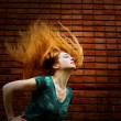Grunge fashion shot of woman with motion hair -  