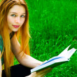 Young woman reading outdoors — Stock Photo #9921738