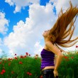 Young woman in poppy field — Stock Photo #9921758
