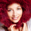 Winter portrait of happy woman with fur hood — Stock Photo #9921774