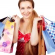 Christmas shopping concept - woman with present bags — ストック写真