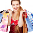 Christmas shopping concept - woman with present bags — Stockfoto