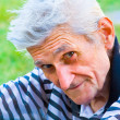 Senior man with wisdom smile — Stock Photo
