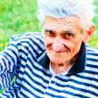 Outdoor portrait of happy bright senior man — Stock Photo