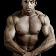 Muscular powerful man showing his muscles — Stock Photo #9922270