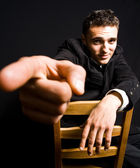 Handsome confident young man with finger pointing — Stock Photo