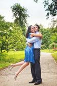 Happy couple - two joyful lovers embracing outdoor — Stock Photo